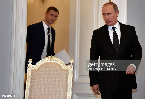 Russian President Vladimir Putin arrives for a meeting with Turkish President in Konstantinovsky Palace outside Saint Petersburg on August 9 2016...