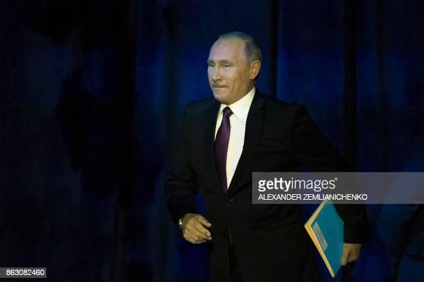 Russian President Vladimir Putin arrives to deliver a speech at the annual Valdai club conference of international experts in Sochi on October 19...