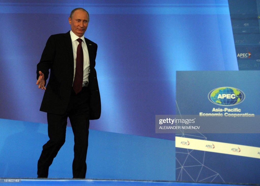 Russian President Vladimir Putin arrives to give a press conference at the end of the Asian-Pacific Economic Cooperation (APEC) Summit in Vladivostok on September 9, 2012. Asia-Pacific leaders will vow to fight protectionism in an effort to defend the stuttering global economy from the eurozone crisis and multiple other threats. AFP PHOTO / ALEXANDER NEMENOV