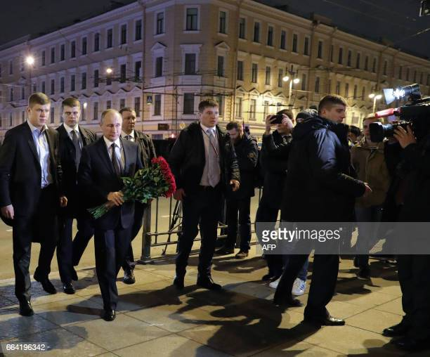 CORRECTION Russian President Vladimir Putin arrives to place flowers in memory of victims of the blast in the Saint Petersburg metro at Technological...