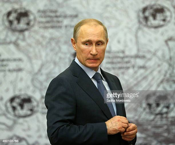 Russian President Vladimir Putin arrives to speak on Arctic developement in the Russian Geographical Society on June 5 2014 in St Petersburg Russia...