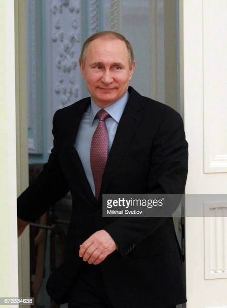 Russian President Vladimir Putin arrives to the meeting with Director of the General Office of the Communist Party of China and Chief of the General...