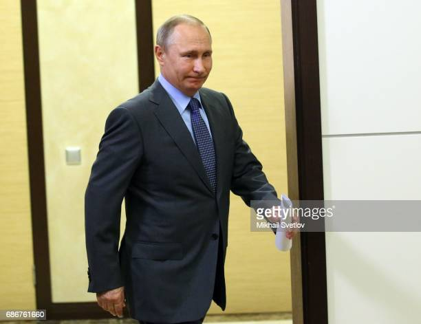 Russian President Vladimir Putin arrives to the meeting with top managers of space industry sector on May 22 2017 in Sochi Russia The number of Earth...