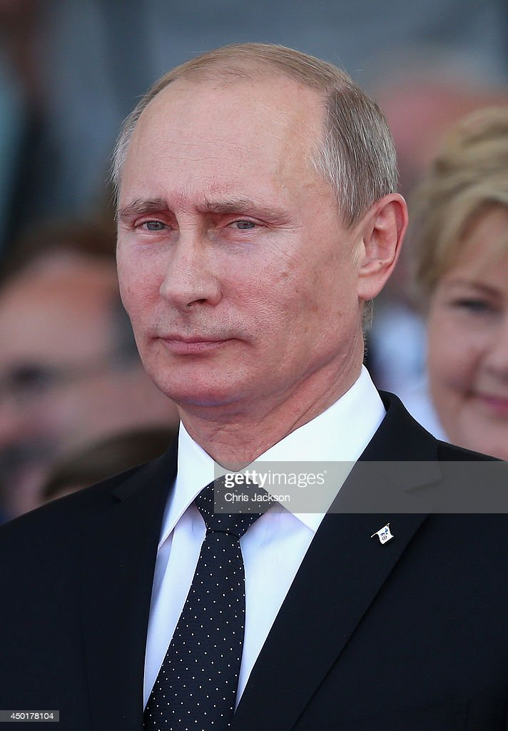 Russian President Vladimir Putin attends a Ceremony to Commemorate DDay 70 on Sword Beach on June 6 2014 in Ouistreham France Friday 6th June is the...
