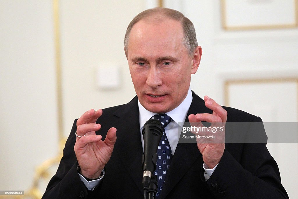 Russian President <a gi-track='captionPersonalityLinkClicked' href=/galleries/search?phrase=Vladimir+Putin&family=editorial&specificpeople=154896 ng-click='$event.stopPropagation()'>Vladimir Putin</a> attends a ceremony with the Russian Military Historical Society on March 14, 2013 in Moscow, Russia. Putin presented state decorations to those involved in patriotic and military history.