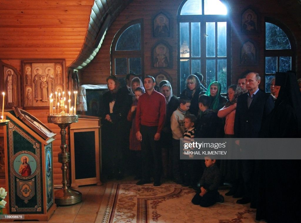 Russian President Vladimir Putin attends a Christmas service in a church in Sochi early on January 7, 2013. Orthodox Christians celebrate Christmas on January 7 in the Middle East, Russia and other Orthodox churches that use the old Julian calendar instead of the 17th-century Gregorian calendar adopted by Catholics, Protestants, Greek Orthodox and commonly used in secular life around the world.