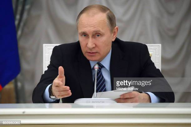Russian President Vladimir Putin attends a meeting of the Presidential council on strategic development and priority projects at the Kremlin on March...