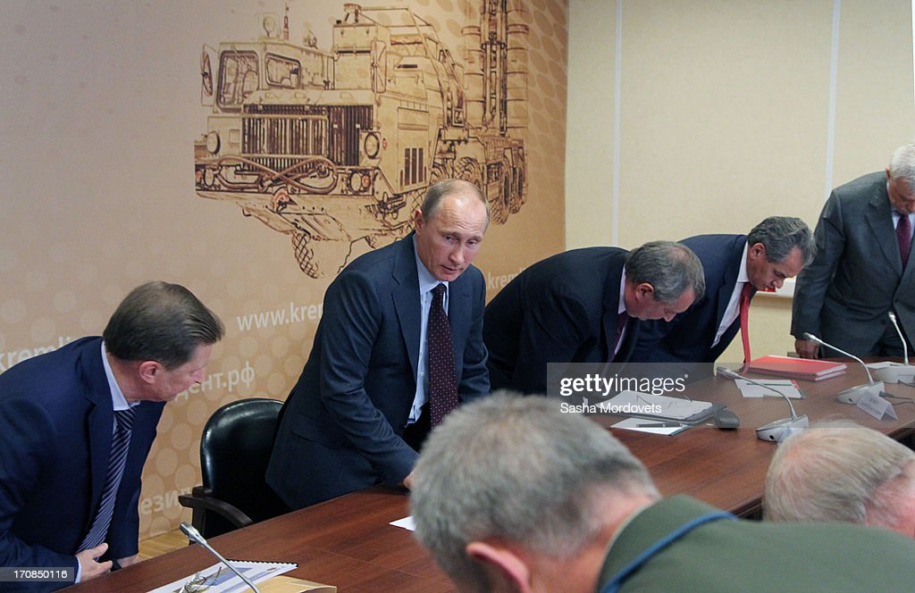 Russian President <a gi-track='captionPersonalityLinkClicked' href=/galleries/search?phrase=Vladimir+Putin&family=editorial&specificpeople=154896 ng-click='$event.stopPropagation()'>Vladimir Putin</a> (C) attends a meeting on military industry development at the Obukhov state planton June 19, 2013 in in Saint Petersburg, Russia. Putin held a meeting at the plant on the development and implementation of military services and equipment.