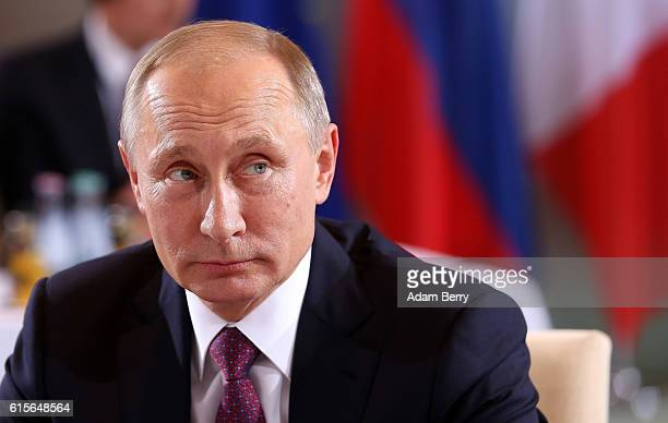 Russian President Vladimir Putin attends a meeting to discuss the Ukrainian peace process at the German federal Chancellery on October 19 2016 in...