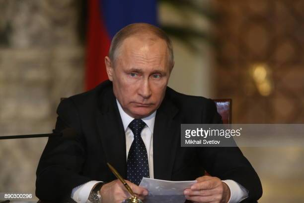 Russian President Vladimir Putin attends a meeting with Egyptian President Abdel Fattah elSisi on December 11 2017 in Cairo Egypt Putin is on a...