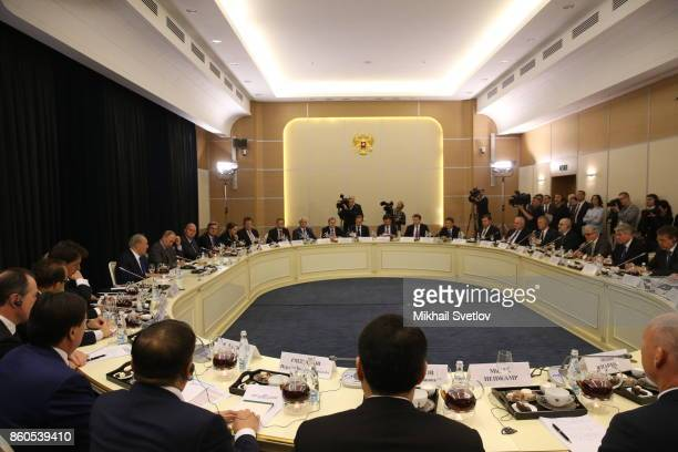 Russian President Vladimir Putin attends a meeting with German businessmen October 12 2017 in Sochi Russia Vladimir Putin receives CEO of major...