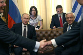 Russian President Vladimir Putin attends a meeting with Greek President Prokopis Pavlopoulos in Athens Greece May 27 2016 Vladimir Putin is having a...