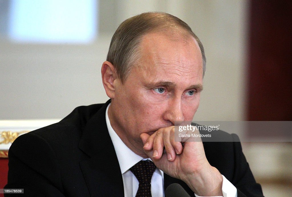 Russian President <a gi-track='captionPersonalityLinkClicked' href=/galleries/search?phrase=Vladimir+Putin&family=editorial&specificpeople=154896 ng-click='$event.stopPropagation()'>Vladimir Putin</a> attends a meeting with Indian Prime Minister Manmohan Singh in the Kremlin on October 21, 2013 in Moscow, Russia, Prime Minister Manmohan Singh is currently on a state visit to Russia.