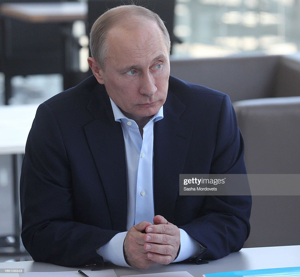 Russian President <a gi-track='captionPersonalityLinkClicked' href=/galleries/search?phrase=Vladimir+Putin&family=editorial&specificpeople=154896 ng-click='$event.stopPropagation()'>Vladimir Putin</a> attends a meeting with members of Russian Figure Scating Federation and Russian Ice Hockey Federation at the Bolshoy Ice Dome, an ice hockey arena in the Sochi Olympic Park on March, 2013 in Russia. Sochi will host the 2014 Winter Olympics.