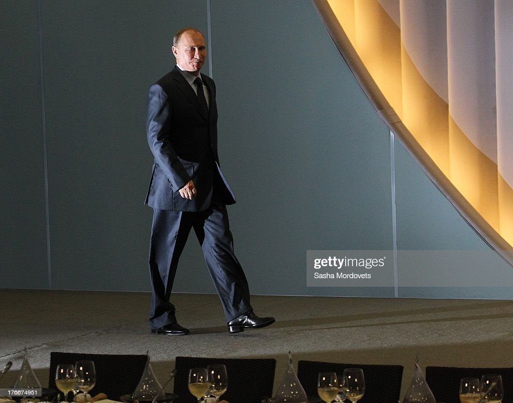 Russian President <a gi-track='captionPersonalityLinkClicked' href=/galleries/search?phrase=Vladimir+Putin&family=editorial&specificpeople=154896 ng-click='$event.stopPropagation()'>Vladimir Putin</a> attends a meeting with members of Dinamo sport club at Bocharov Ruchey residence on August 17, 2013 in Sochi, Russia. Putin will spend time in his Black Sea resort residence for meetings.