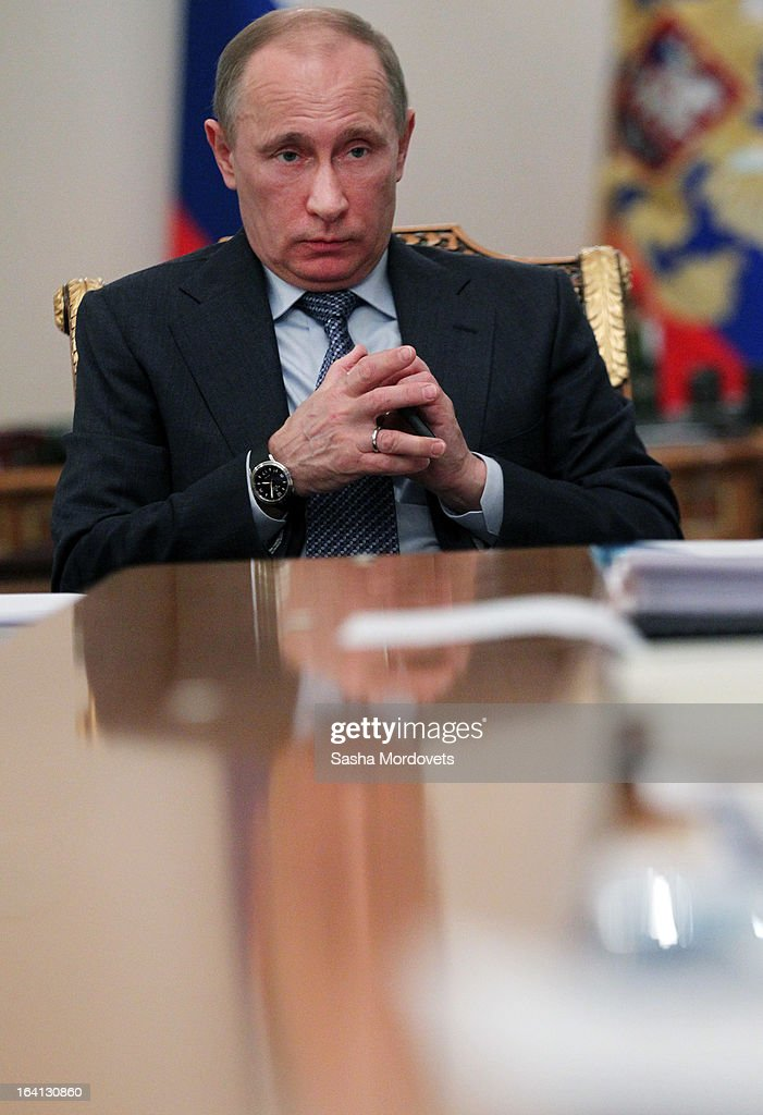 Russian President <a gi-track='captionPersonalityLinkClicked' href=/galleries/search?phrase=Vladimir+Putin&family=editorial&specificpeople=154896 ng-click='$event.stopPropagation()'>Vladimir Putin</a> attends a meeting with ministers and delegates from energy companies on March 20, 2013 in Moscow, Russia. Putin is due to meet China's new leader Xi Jinping later this week and 'key issues of bilateral cooperation' including energy, investments and the ongoing conflict in Syria are on the agenda for discussion.