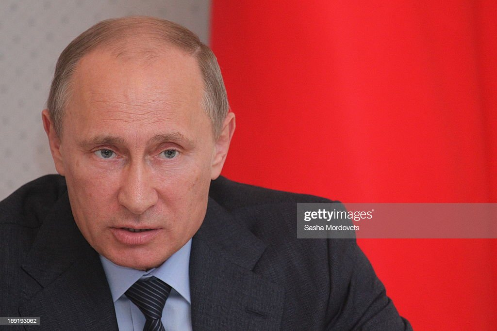 Russian President <a gi-track='captionPersonalityLinkClicked' href=/galleries/search?phrase=Vladimir+Putin&family=editorial&specificpeople=154896 ng-click='$event.stopPropagation()'>Vladimir Putin</a> attends a meeting with ministers and other officials at Bocharov Ruchey state residence on May 21, 2013 in Sochi, Russia. Putin held a meeting with officials on United Shipbilding Company.