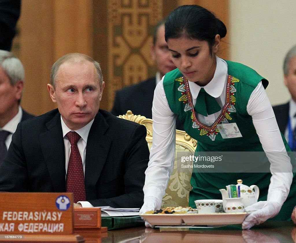 Russian President <a gi-track='captionPersonalityLinkClicked' href=/galleries/search?phrase=Vladimir+Putin&family=editorial&specificpeople=154896 ng-click='$event.stopPropagation()'>Vladimir Putin</a> attends a session of CIS Summit on December, 5, 2012 in Ashgabat, Turkmenistan. Leaders of former Soviet republics gathered for the Commonwealth of the Independent States Summit where President Putin stated he will defend the CIS at future G8 and G20 meetings.