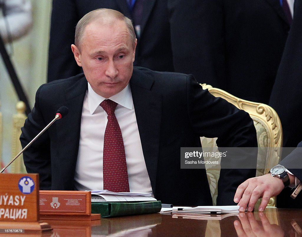 Russian President <a gi-track='captionPersonalityLinkClicked' href=/galleries/search?phrase=Vladimir+Putin&family=editorial&specificpeople=154896 ng-click='$event.stopPropagation()'>Vladimir Putin</a> attends a session of the Commonwealth of the Independent States (CIS) Summit on December 5, 2012 in Ashgabat, Turkmenistan. Leaders of former Soviet republics gathered for the CIS Summit where President Putin stated he will defend the CIS at future G8 and G20 meetings.