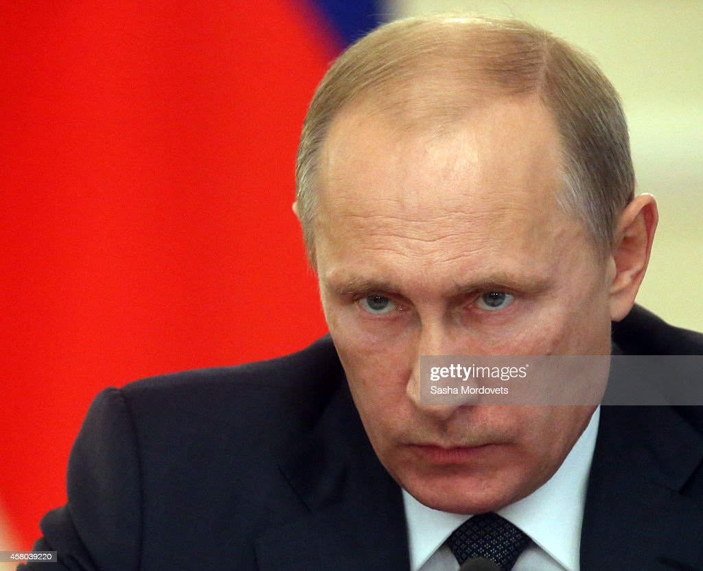 Russian President <a gi-track='captionPersonalityLinkClicked' href=/galleries/search?phrase=Vladimir+Putin&family=editorial&specificpeople=154896 ng-click='$event.stopPropagation()'>Vladimir Putin</a> attends a weekly meeting with ministers of the government at the Novo Ogaryovo state residence October 29, 2014 in Moscow Russia.