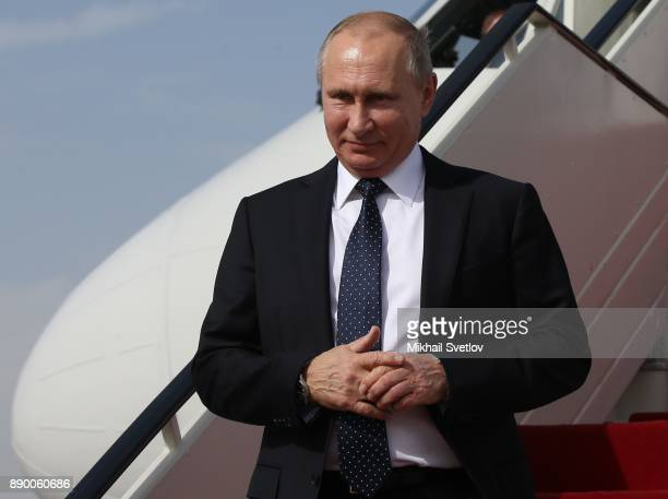 Russian President Vladimir Putin attends a welcoming ceremony at the airport on December 11 2017 in Cairo Egypt Putin is having a oneday trip to...