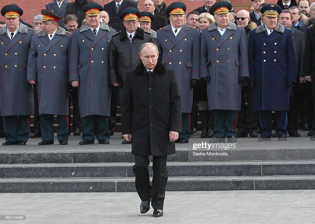 Russian President <a gi-track='captionPersonalityLinkClicked' href=/galleries/search?phrase=Vladimir+Putin&family=editorial&specificpeople=154896 ng-click='$event.stopPropagation()'>Vladimir Putin</a> attends a wreath laying ceremony at the tomb of the Unknown Soldier, near Kremlin wall on February 23, 2013 in Moscow, Russia. Russians are commemorating the Defender of the Fatherland Day - formerly known as Soviet Army Day - which marks the date in 1918 of the first mass draft into the Red Army during the Russian Civil War.