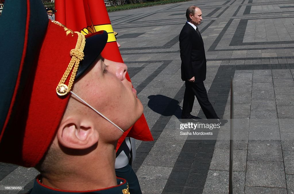 Russian President <a gi-track='captionPersonalityLinkClicked' href=/galleries/search?phrase=Vladimir+Putin&family=editorial&specificpeople=154896 ng-click='$event.stopPropagation()'>Vladimir Putin</a> attends a wreath laying ceremony at the Tomb of the Unknown Soldier near the Kremlin on May, 8 2013 in Moscow, Russia. Russia will tomorrow hold traditional parades to mark the 68th anniversary of the defeat of Nazi Germany in World War II.