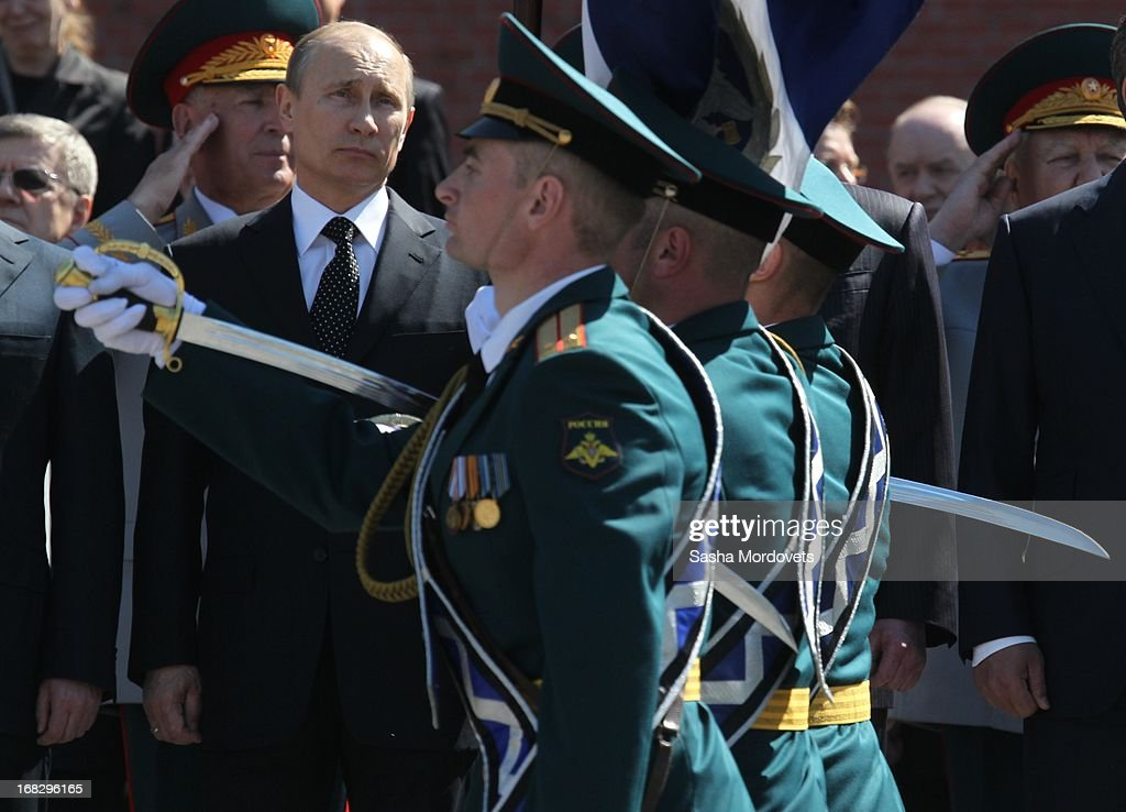 Russian President Vladimir Putin attends a wreath laying ceremony at the Tomb of the Unknown Soldier near the Kremlin on May, 8 2013 in Moscow, Russia. Russia will hold victory parades tomorrow to mark the 68th anniversary of the defeat of Nazi Germany in World War II.