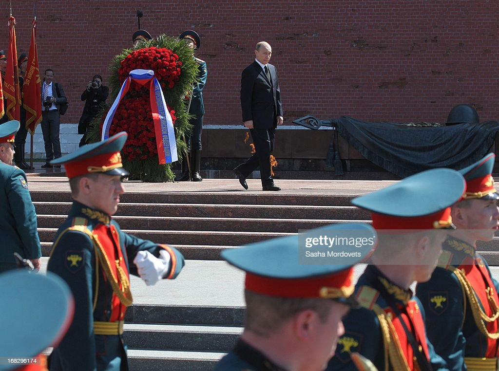 Russian President <a gi-track='captionPersonalityLinkClicked' href=/galleries/search?phrase=Vladimir+Putin&family=editorial&specificpeople=154896 ng-click='$event.stopPropagation()'>Vladimir Putin</a> (C) attends a wreath laying ceremony at the Tomb of the Unknown Soldier near the Kremlin on May, 8 2013 in Moscow, Russia. Russia will hold victory parades tomorrow to mark the 68th anniversary of the defeat of Nazi Germany in World War II.