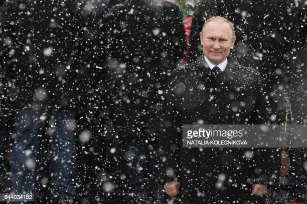 TOPSHOT Russian President Vladimir Putin attends a wreath laying ceremony at the Tomb of the Unknown Soldier by the Kremlin wall to mark the Defender...
