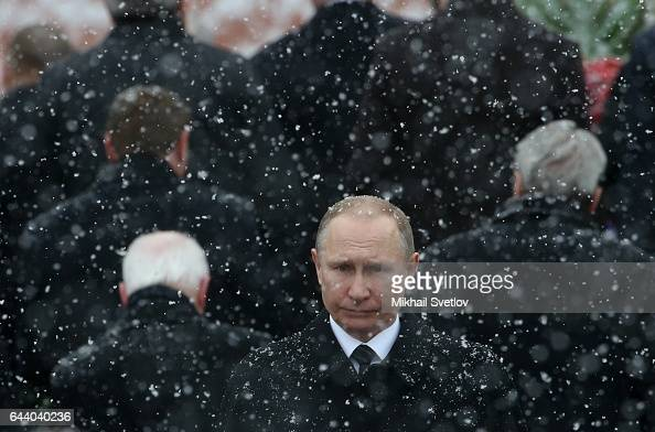 Russian President Vladimir Putin attends a wreath laying ceremony to the Tomb of Unknown Soldier marking the Defender of the Fatherland Day on...