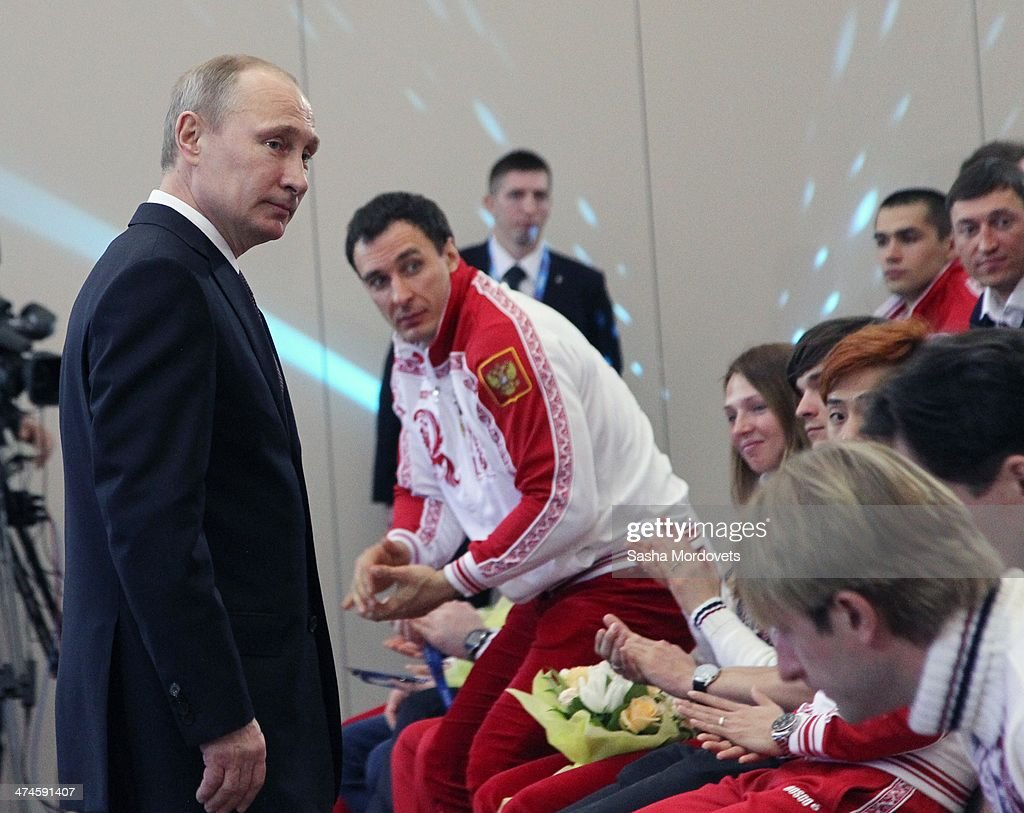 Russian President <a gi-track='captionPersonalityLinkClicked' href=/galleries/search?phrase=Vladimir+Putin&family=editorial&specificpeople=154896 ng-click='$event.stopPropagation()'>Vladimir Putin</a> attends an awards ceremony for Russian Olympic athletes on February 24, 2014 in Sochi, Russia. Russian President <a gi-track='captionPersonalityLinkClicked' href=/galleries/search?phrase=Vladimir+Putin&family=editorial&specificpeople=154896 ng-click='$event.stopPropagation()'>Vladimir Putin</a> presented awards to members of the Russian Olympic team a day after the closing ceremony of the 2014 Winter Olympics, in which Russia topped the medals table with 13 gold, 11 silver and 9 bronze medals.