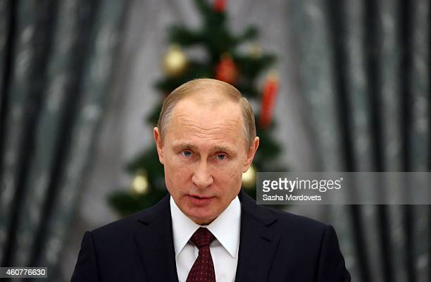Russian President Vladimir Putin attends an awards ceremony in the Kremlin on December 22 2014 in Moscow Russia