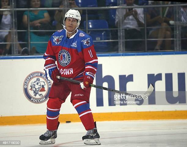 Russian President Vladimir Putin attends an ice hockey match of the Night Hockey League on October 7 2015 in Sochi Russia Russian President Vladimir...