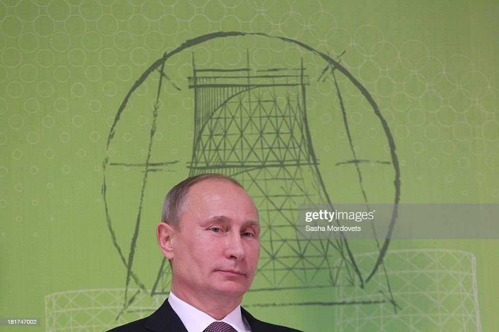 Russian President <a gi-track='captionPersonalityLinkClicked' href=/galleries/search?phrase=Vladimir+Putin&family=editorial&specificpeople=154896 ng-click='$event.stopPropagation()'>Vladimir Putin</a> attends in the opening of the new gas-fired thermal power plant Nyagan GRES on September 24, 2013 in Nyagan, Siberia, Russia. The largest greenfield thermal power plant project in Russia since 1990, the massive site will have a power generation capacity of over 1,250 megawatts