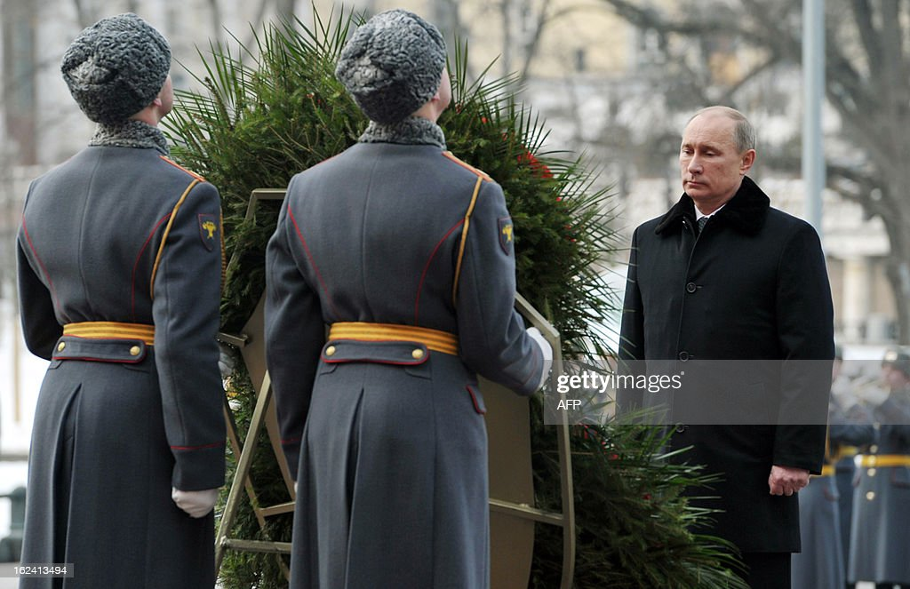 Russian President Vladimir Putin (R) attends the ceremony of laying flowers to the Tomb of the Unknown Soldier by the Kremlin wall to mark the Defenders of the Fatherland Day holiday in Moscow on February 23, 2013. The Defenders of the Fatherland Day, celebrated in Russia on February 23, honors the nation's army and is a nationwide holiday. AFP PHOTO / RIA NOVOSTI / PRESIDENTIAL PRESS SERVICE / ALEXEY NIKOLSKY