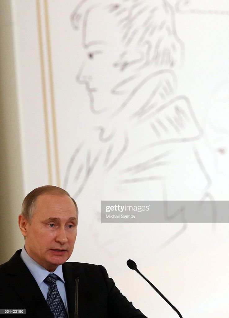 Russian President <a gi-track='captionPersonalityLinkClicked' href=/galleries/search?phrase=Vladimir+Putin&family=editorial&specificpeople=154896 ng-click='$event.stopPropagation()'>Vladimir Putin</a> attends the Congress of Russian Literature and Society on May 26, 2016 in Moscow, Russia.