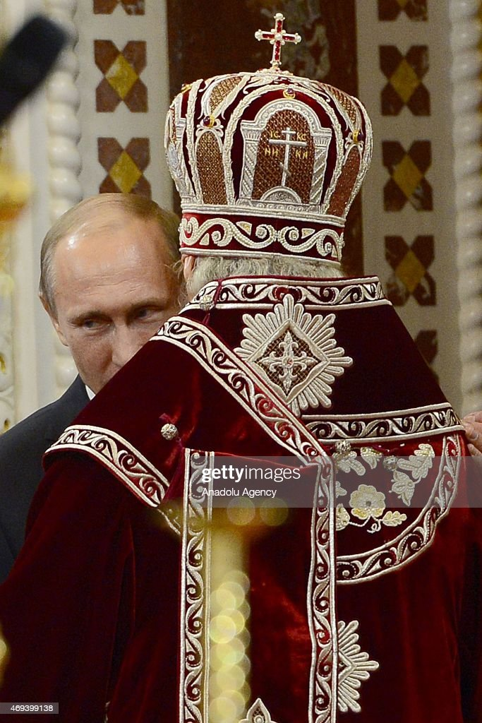 Russian President <a gi-track='captionPersonalityLinkClicked' href=/galleries/search?phrase=Vladimir+Putin&family=editorial&specificpeople=154896 ng-click='$event.stopPropagation()'>Vladimir Putin</a> attends the Easter service led by Patriarch Kirill of Russia (R) in Christ the Savior Cathedral in Moscow, Russia on April 12, 2015. Orthodox Christian believers mark the Holy Week of Easter in celebration of the crucifixion and resurrection of Jesus Christ.