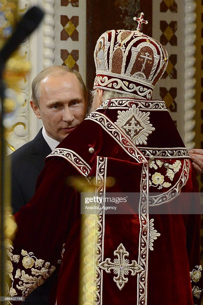Russian President Vladimir Putin attends the Easter service led by Patriarch Kirill of Russia (R) in Christ the Savior Cathedral in Moscow, Russia on April 12, 2015. Orthodox Christian believers mark the Holy Week of Easter in celebration of the crucifixion and resurrection of Jesus Christ.