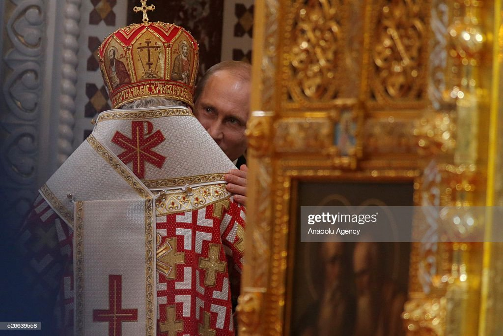 Russian President Vladimir Putin attends the Easter service led by Patriarch Kirill of Russia in Christ the Savior Cathedral in Moscow on April 30, 2016.