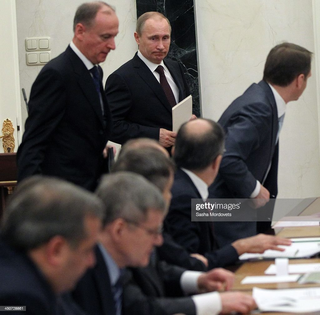 Russian President Vladimir Putin (C) attends the Security Council meeting in the Kremlin on November 20,2013 Moscow, Russia. Members of the Security Council discussed the ecology problems going on in the country today.