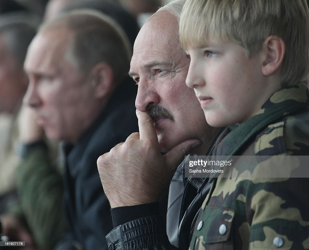 Russian President <a gi-track='captionPersonalityLinkClicked' href=/galleries/search?phrase=Vladimir+Putin&family=editorial&specificpeople=154896 ng-click='$event.stopPropagation()'>Vladimir Putin</a> (L), Belarussian President <a gi-track='captionPersonalityLinkClicked' href=/galleries/search?phrase=Alexander+Lukashenko&family=editorial&specificpeople=542572 ng-click='$event.stopPropagation()'>Alexander Lukashenko</a> (C) and his son Nikolai watch joint Russian-Belarussian military exercises at the polygon on September 26, 2013 in Grodno, Belarus.