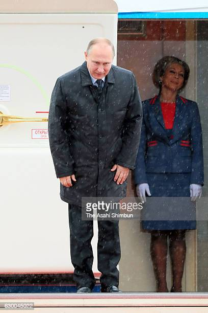 Russian President Vladimir Putin bows before boarding on departure at Yamaguchi Ube Airport on December 16 2016 in Ube Yamaguchi Japan Putin is on a...