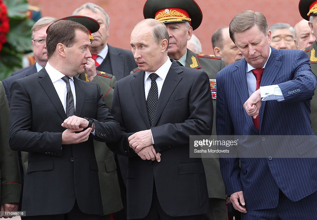 Russian President <a gi-track='captionPersonalityLinkClicked' href=/galleries/search?phrase=Vladimir+Putin&family=editorial&specificpeople=154896 ng-click='$event.stopPropagation()'>Vladimir Putin</a> (C), Chief of Presidental Administration Sergey Ivanov (R) and Prime Minister <a gi-track='captionPersonalityLinkClicked' href=/galleries/search?phrase=Dmitry+Medvedev&family=editorial&specificpeople=554704 ng-click='$event.stopPropagation()'>Dmitry Medvedev</a> (L) attend a wreath laying ceremony at the Tomb of the Unknown Soldier in Alexander Garden near the Kremlin on June, 22, 2013 in Moscow, Russia. The ceremony marks the 72nd anniversary (June 22nd, 1941) of the Nazi German invasion of the Soviet Union during World War II.