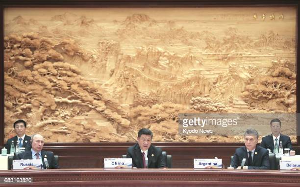 Russian President Vladimir Putin Chinese President Xi Jinping and Argentine President Mauricio Macri attend a roundtable summit at the Belt and Road...