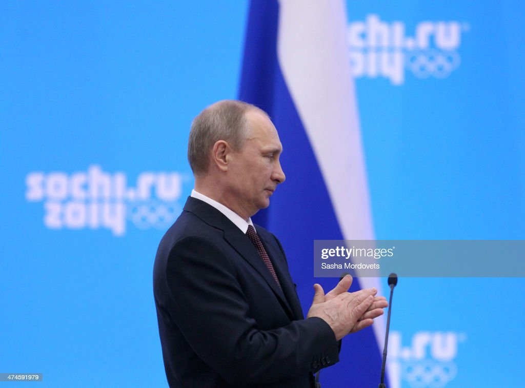 Russian President <a gi-track='captionPersonalityLinkClicked' href=/galleries/search?phrase=Vladimir+Putin&family=editorial&specificpeople=154896 ng-click='$event.stopPropagation()'>Vladimir Putin</a> claps during an awards ceremony for Russian Olympic athletes on February 24, 2014 in Sochi, Russia. Russian President <a gi-track='captionPersonalityLinkClicked' href=/galleries/search?phrase=Vladimir+Putin&family=editorial&specificpeople=154896 ng-click='$event.stopPropagation()'>Vladimir Putin</a> presented awards to members of the Russian Olympic team a day after the closing ceremony of the 2014 Winter Olympics, in which Russia topped the medals table with 13 gold, 11 silver and 9 bronze medals.