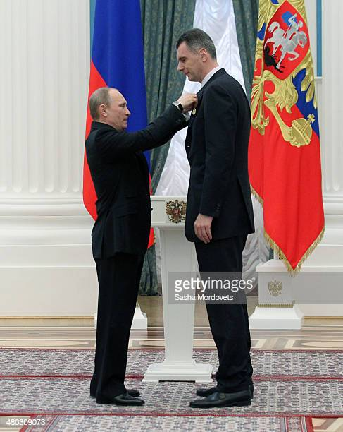 Russian President Vladimir Putin congradulates businessman Mikhail Prokhorov during a state award ceremony honoring participants of the Olympic and...