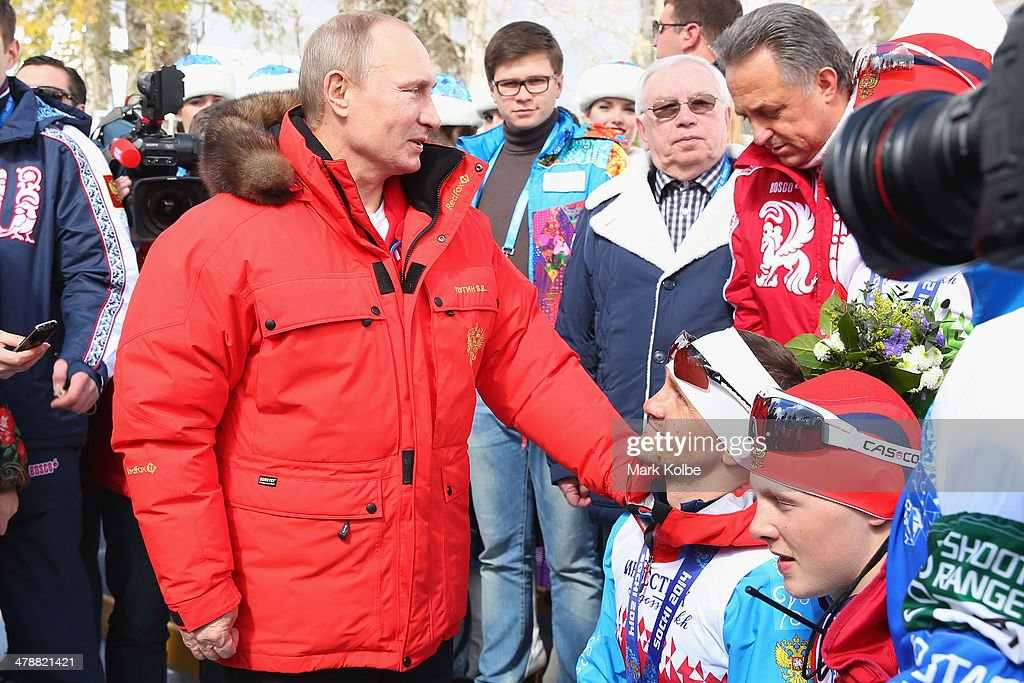 Russian President Vladimir Putin congratulates Roman Petushkov of Russia and his team after their victory in the 4 x 2.5km Open Relay cross-country on day eight of the Sochi 2014 Paralympic Winter Games at Laura Cross-country Ski & Biathlon Center on March 15, 2014 in Sochi, Russia.