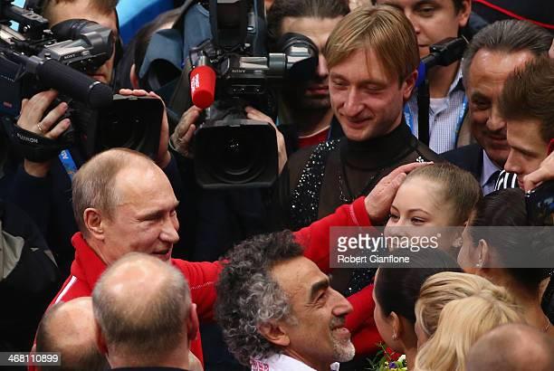 Russian President Vladimir Putin congratulates Yulia Lipnitskaya of Russia after the Team Figure Skating event on day 2 of the Sochi 2014 Winter...