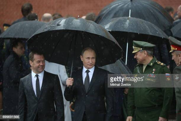 Russian President Vladimir Putin Defence Minister Sergei Shoigu and Prime Minister Dmitry Medvedev attend the wreath laying ceremony at the Unknown...